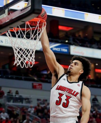 Louisville's Jordan Nwora with a slam dunk against EKU in the KFC Yum Center on Dec. 14, 2019.