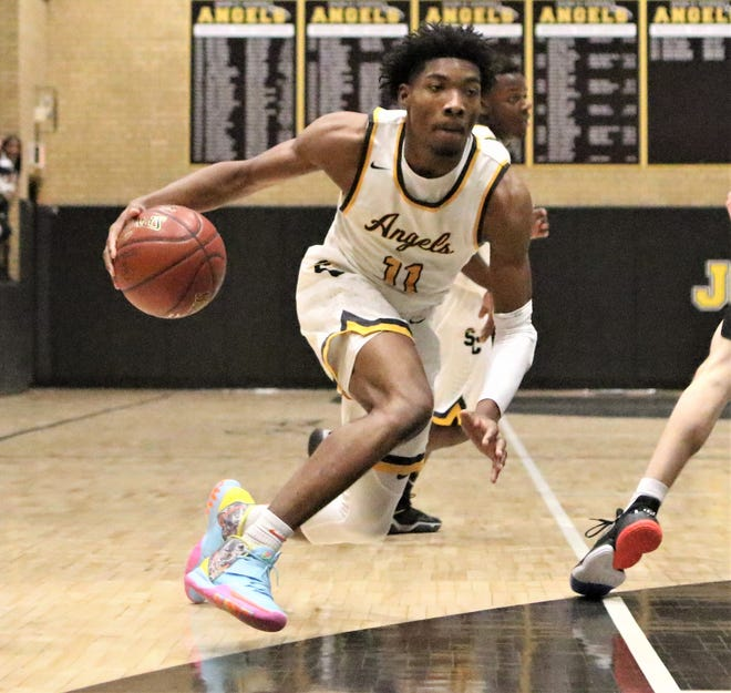 Racine St. Catherine's guard Tyrese Hunter heads toward the rim against Martin Luther during a game on December 13, 2019.