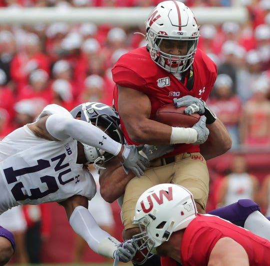 Badgers tailback Jonathan Taylor has rushed for 1,909 yards and 21 touchdowns this season.