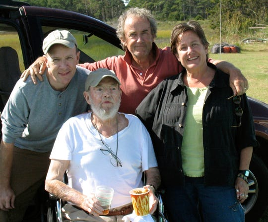 In this Sept. 29, 2009 photo provided by Betsy McNair, Robert McNair, center, poses with his children from left to right, Paul, Mark, and Betsy at Bulls Landing on Mockhorn Bay outside of Townsend, on the Eastern Shore of Virginia. Robert McNair was 83 when he died at his home in Belle Haven, Virginia, in 2009, six weeks after learning he had lung cancer. Betsy, who besides her father, helped care for her brother Paul who died of Lou Gehrig's disease in his 50s, and her mother, who died at age 92 in a nursing home after a long decline in health, is proud of the ending she helped give her father.
