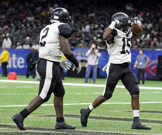 Oak Grove running back Otis Moore (15) celebrates with fellow running back Ron Craten (2)  after he scores a touchdown in the first quarter of the LHSAA Class 1A football state championship game at the Mercedes-Benz Superdome in New Orleans. Craten was voted the game's Most Valuable Player.