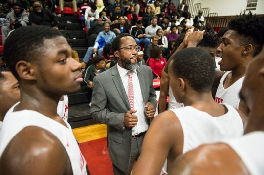 Lee coach Bryant Johnson talks with his team during a timeout at Robert E. Lee High School in Montgomery, Ala., on Friday, Dec. 13, 2019.