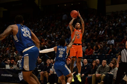 Auburn guard J'Von McCormick shoots a 3-pointer against Saint Louis at the Mike Slive Invitational in Birmingham.