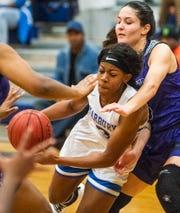 Marbury's Renijah Brown (3) drives against Prattville Christian's Tori DeMaio (5) in basketball tournament action at Marbury High School in Marbury, Ala., on Saturday December 14, 2019.
