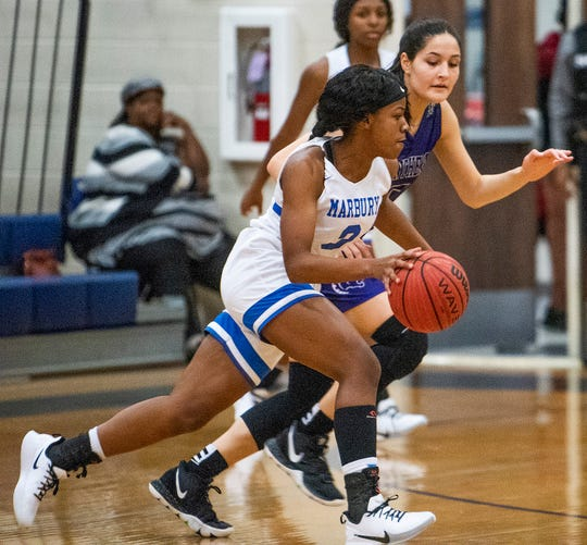 Marbury's Renijah Brown (3) is defended by Prattville Christian's Tori DeMaio (5) in basketball tournament action at Marbury High School in Marbury, Ala., on Saturday December 14, 2019.