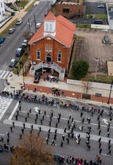 The Alabama Bicentennial Parade makes its way past the Dexter Avenue King memorial baptist Church in downtown Montgomery, Ala., on Saturday December 14, 2019.