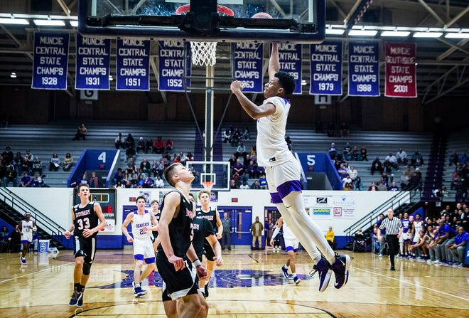 Central's Ben Watkins dunks against Logansport's defense during their game at the Muncie Fieldhouse Friday, Dec. 13, 2019.