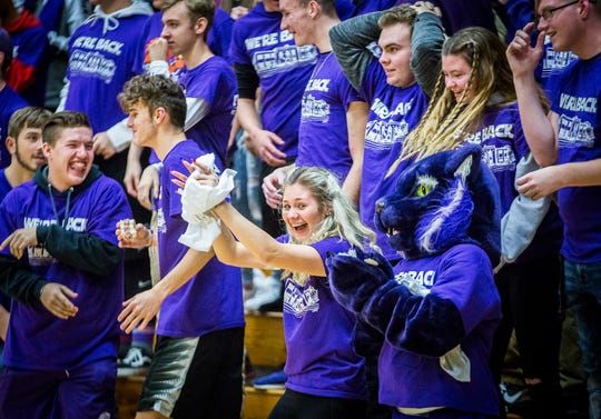 Purple-clad fans fill the stands of the Muncie Fieldhouse on Friday, Dec. 13, 2019, for a double-header basketball game and the re-dedication of the historic gym.