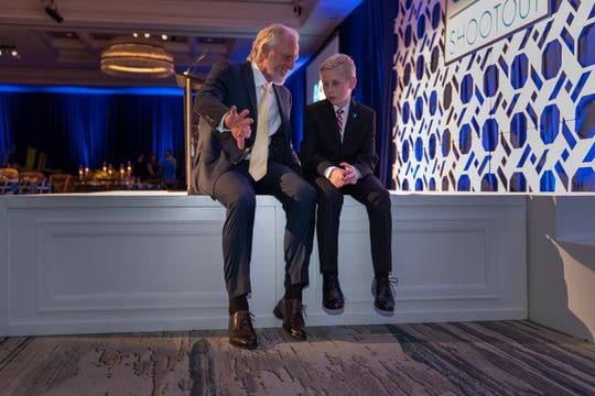 QBE Shootout founder and host Greg Norman speaks with Chase Hancock, the Cure Search for Children's Cancer honoree, at the Shootout gala on Thursday, Dec. 12, 2019.
