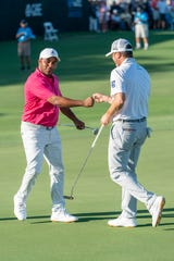 Harold Varner III and Ryan Palmer celebrate a birdie on No.  18 to end the second round of the QBE Shootout was played on Saturday, Dec. 14, 2019 at Tiburon Golf Club at the Ritz-Carlton Golf Resort. Varner and Palmer and four other teams are tied for the lead going into the final round Sunday.