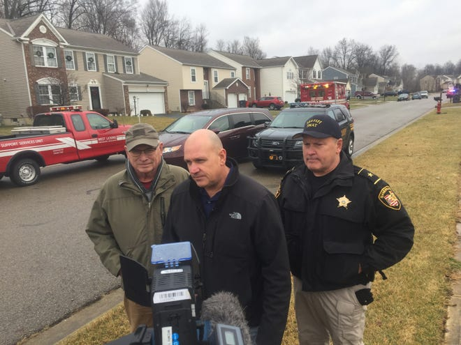Licking County Prosecutor Bill Hayes, Pataskala Deputy Police Chief Michael Boals and Licking County Sheriff Randy Thorp meet with reporters at the scene of a fatal shooting in Pataskala Saturday afternoon.