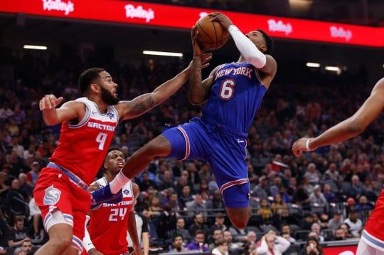 Sacramento Kings guard Cory Joseph, left, fouls New York Knicks guard Elfrid Payton, right, during the first quarter of an NBA basketball game in Sacramento, Calif., Friday, Dec. 13, 2019.