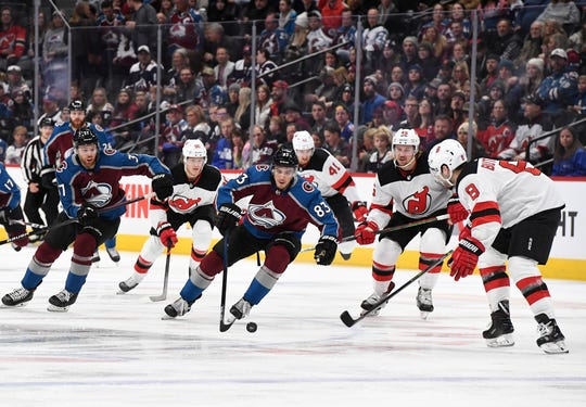Colorado Avalanche's Matt Nieto (83) advances the puck upice against the New Jersey Devils in the first period  of an NHL hockey game Friday, Dec. 13, 2019, in Denver.