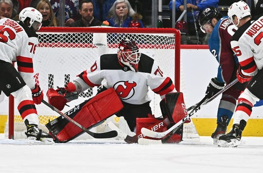 Dec 13, 2019; Denver, CO, USA; Colorado Avalanche left wing Gabriel Landeskog (92) attempts on New Jersey Devils goaltender Louis Domingue (70) in the first period at the Pepsi Center.