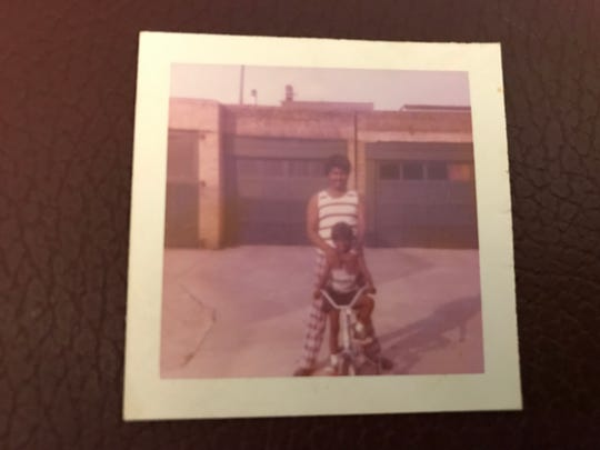 The author of this story, Ricardo Kaulessar, sitting on his first bike at five years old with his dad, Daydatt, in the backyard of his childhood home in the Greenville section of Jersey City.