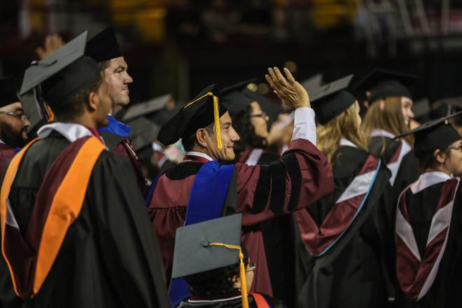 Students receive their doctoral and master's degree at the New Mexico State University commencement ceremony at the Pan American Center in Las Cruces on Friday, Dec. 13, 2019.