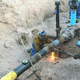 A worker from Las Cruces Utilities installs a main line for natural gas.