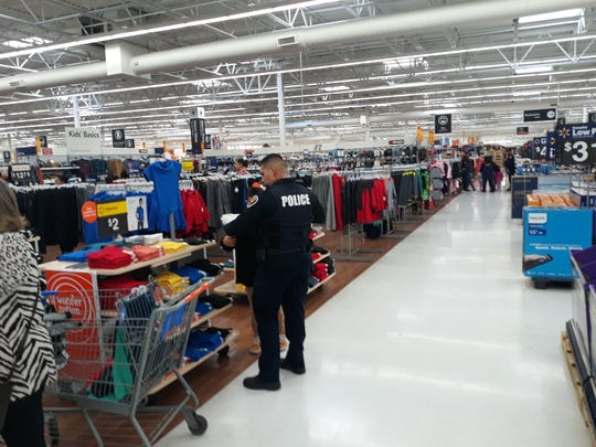 An officer from the Las Cruces Police Department shops with a local family during the Shop with a Cop event on Saturday, Dec. 6, 2019. The annual event is organized by the Las Cruces Fraternal Order of Police Lodge #8.