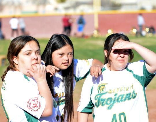 Destiny Lewis (left), Haley Parra (center) and Priscilla Lewis (right) watch their teammates play in this year's Mayfield High School Unified Champion Schools kickball game held at Field of Dreams on Dec. 13, 2019.
