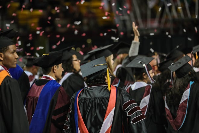 Students receive their doctoral and master's degrees at the New Mexico State University commencement ceremony at the Pan American Center in Las Cruces on Friday, Dec. 13, 2019.