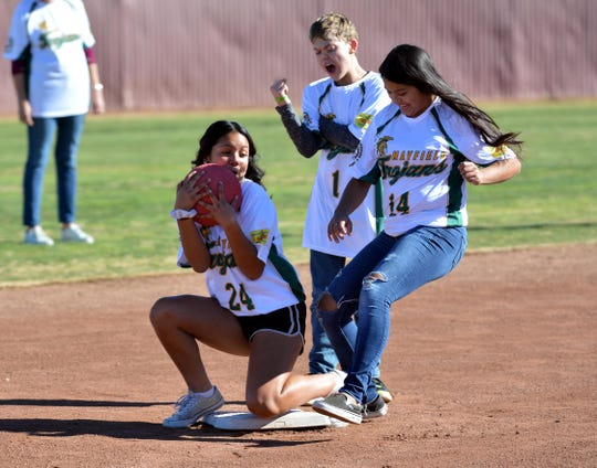 Mayfield student Elizabeth Cruz (24) gets Diana Carrasco (14) out at second base during Friday afternoon's Mayfield High School Unified Champion Schools kickball game on Dec. 13, 2019.