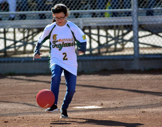 Angelina Gonzales kicks the ball for a single during the first annual Mayfield High School Unified Champion Schools kickball game on Dec. 13, 2019.