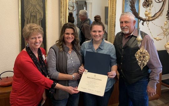 Breanna Simpson, second from right, was awarded the Doña Ana Chapter Daughters of the American Revolution Good Citizen Award at the organization's December Christmas Tea. Also pictured are Susie Coker, Good Citizen Award committee chair; Brenda Taylor, Simpson's mother, and Jimmy Simpson, her father.