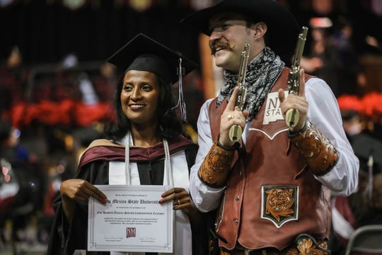 Eden Kassaye Gebremichael poses with Pistol Pete at the New Mexico State University commencement ceremony at the Pan American Center in Las Cruces on Friday, Dec. 13, 2019.