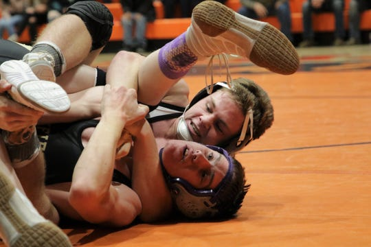 Aztec's Hunter Riddick locks up Bayfield's Trey McKee in the 160-pound division during Friday's wrestling duals at Lillywhite Gym in Aztec. Riddick won via pin at the 4:48 mark.