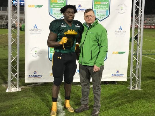 Pensacola Catholic's Ja'Kobi Jackson (left) is selected as the Offensive MVP in the Subway High School All-Star Game on Dec. 13, 2019.