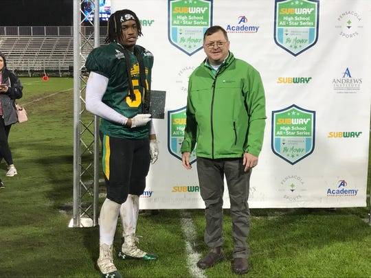 Booker T. Washington's Eric Thomas Jr. (left) is selected as the Defensive MVP for the West team in the Subway High School All-Star Game on Dec. 13, 2019.