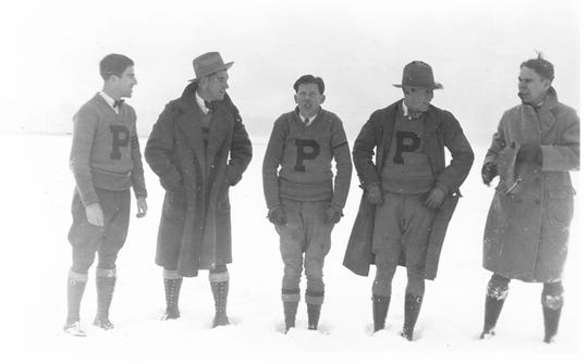 The Phoenix College 1926-27 men's basketball team in Flagstaff playing in the snow.
