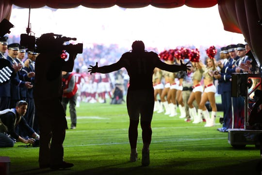 Cardinals receiver Larry Fitzgerald (11) takes the field before a game against the Rams on Dec. 1 at State Farm Stadium.