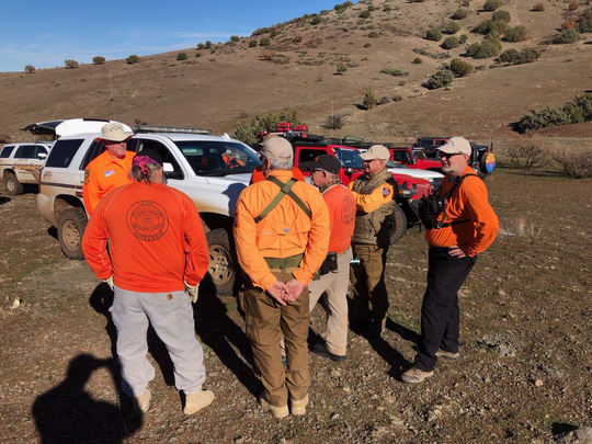 Yavapai County Search and Rescue Team volunteers gather near the crash site