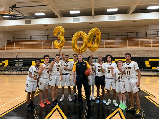 Dave Stark celebrates his 300th win at Marcos de Niza with his team on Friday.