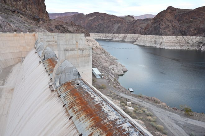 One of Lake Mead's spillways sits empty in 2019. The last time water lapped at the spillway gates was early 2000. The reservoir has fallen during two decades of mostly dry years worsened by rising temperatures.