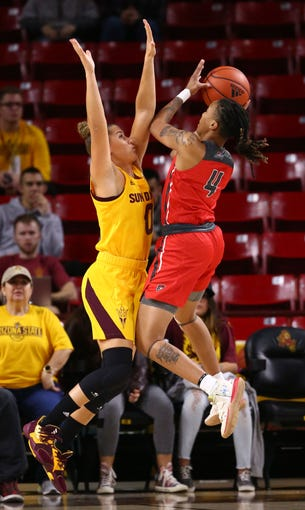 Arizona State Sun Devils guard Taya Hanson (0) pressures the shot by New Mexico Lobos guard Jayla Everett (4) in the first half on Dec. 14, 2019 in Tempe, Ariz.
