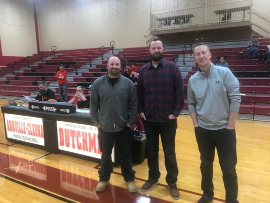 Members of the 1999 Annville-Cleona boys basketball team, from left, Kevin Zimmerman, Jeff Browning and Vince Hoover returned to their alma mater on Friday night as the school honored the team prior to A-C's home opener vs. Columbia