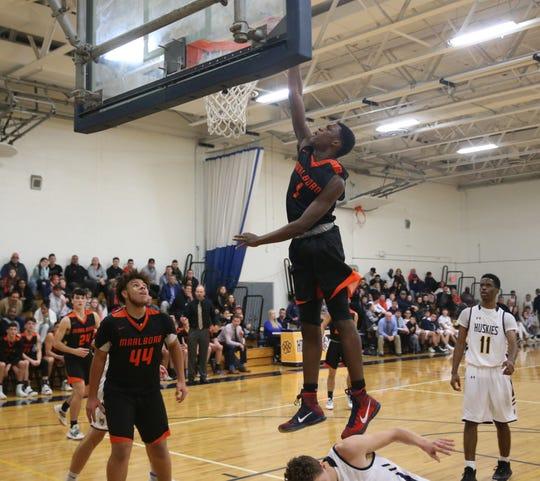 Marlboro's Korbyn Samuels dunks on an opponent during a boys basketball game against Highland on Dec. 13, 2019.