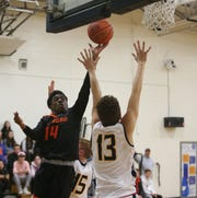 Marlboro's Chinedu Okasi makes a run on the net ahead of Highland's Ronnie Byers during Friday's game on December 13, 2019.