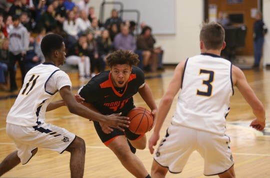 Marlboro's CJ' Mahlo Faircloth drives between Highland's, from left, Monday Baker and Deryk Barry during Friday's game on December 13, 2019.