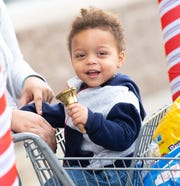 Treyvon Epright, 1, tries his hand at ringing the bell.