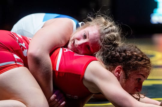 York County's Tiffani Baublitz (blue) wrestles Montgomery Villages Maryland's Seda Tsarni (red) during the Rumble in the Jungle intermission, Friday, December 13, 2019.