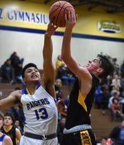 Reed's Neill Baysa attempts to block a shot by Galena's Isaac Wood during a recent game at Reed.