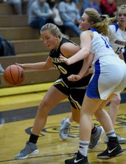 Galena's Hannah Hartley drives against Reed's Jasmin Churchill during a recent game at Reed.