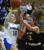 Reed's Riley Robinson shoots against Galena's McKenzie Landon during a recent game at Reed.