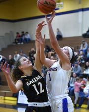 Reed's Emma Johnson, right, shoot against Galena's McKenzie Landon during a recent game at Reed High School.