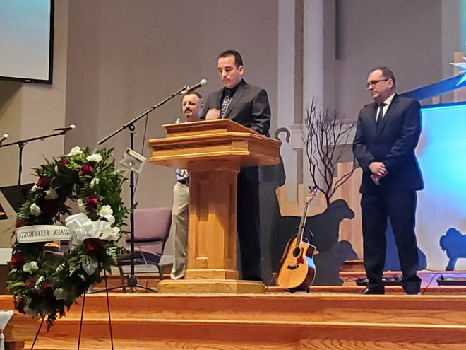 Kevin Strohmayer eulogizes his father, John Strohmayer, at CrossPointe Community Church in Redding on Saturday, Dec. 14, 2019. He is joined by his brothers, Tim Strohmayer, left, and Steve Strohmayer.