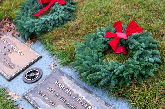 Wreaths are laid on the graves of veterans at Restlawn Memory Gardens & Funeral Home in Salem on Dec. 14. The Dallas Old Guard Riders and volunteers coordinated a local Wreaths Across America at Restlawn, placing 681 wreaths on veteran graves.