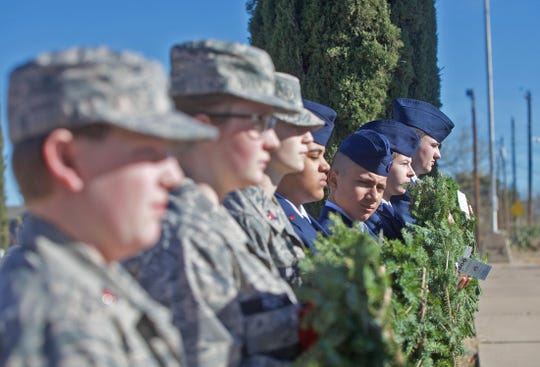 Military personnel attend a Wreaths Across America ceremony at Belvedere Memorial Park on Saturday, Dec. 14, 2019.